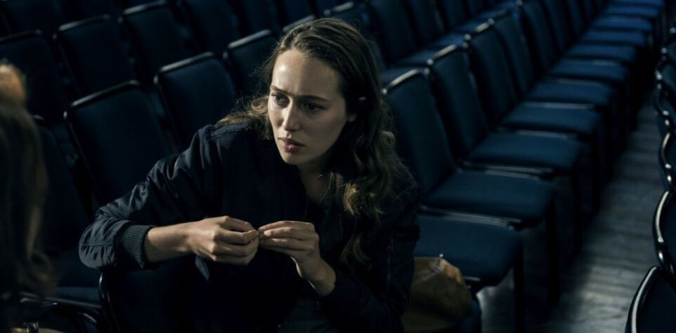 Scene 127; INT Newkirk University main hall; Caroline (Susan Danford) worried about Laura (Alycia Debnam - Carey), wants her to come home, vision of bald Laura
